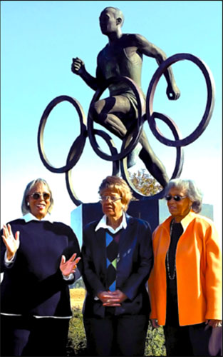 (L-R) Marlene Owens Rankin, Beverly Owens Prather and Gloria Owens Hemphill in front of the statue at the park.