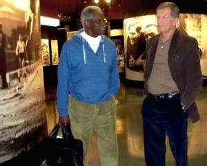 Ralph Boston (left) with James Pinion, touring the Jesse Owens Museum in Oakville. In 1960 Mr. Boston broke Owens' world record distance in the long jump event, held by Owens for 25 years.